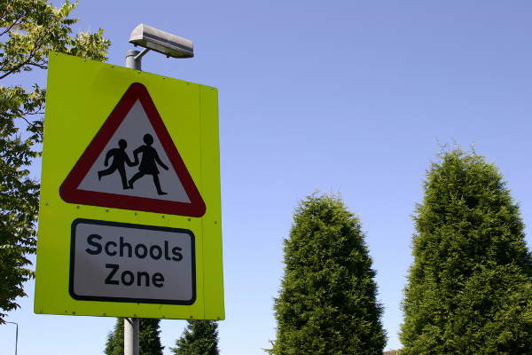 Children crossing school sign