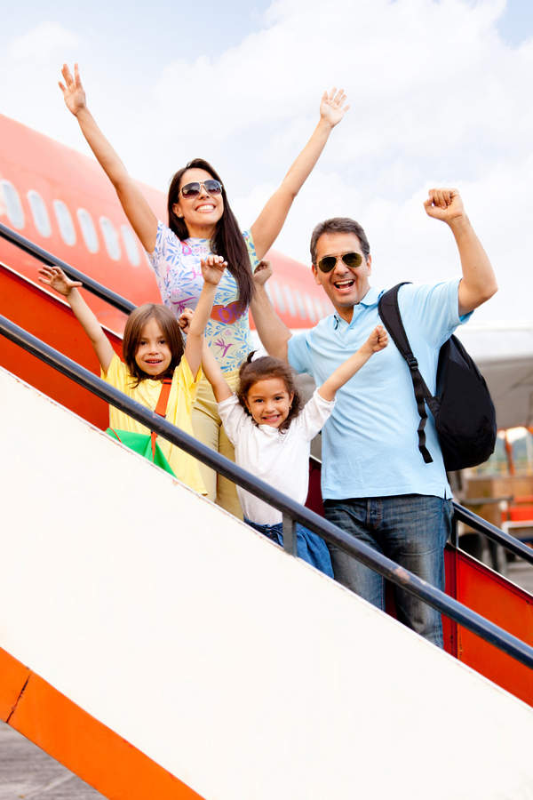 Family getting on plane for holiday