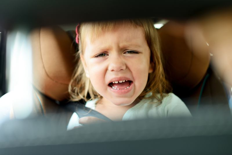 Toddler crying in rear view mirror
