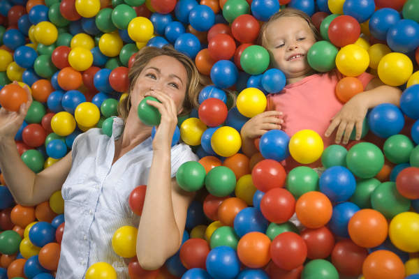 Woman and child in ball pool