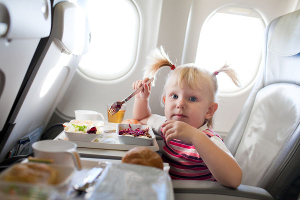 Toddler eating on plane