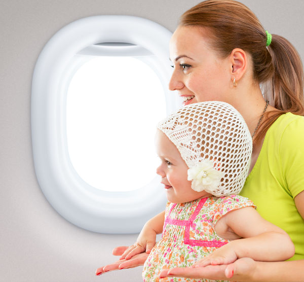 Woman and baby in plane