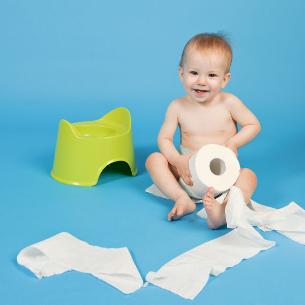 Baby unraveling toilet paper