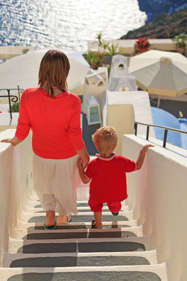 Mother and child in Greece walking down stairs