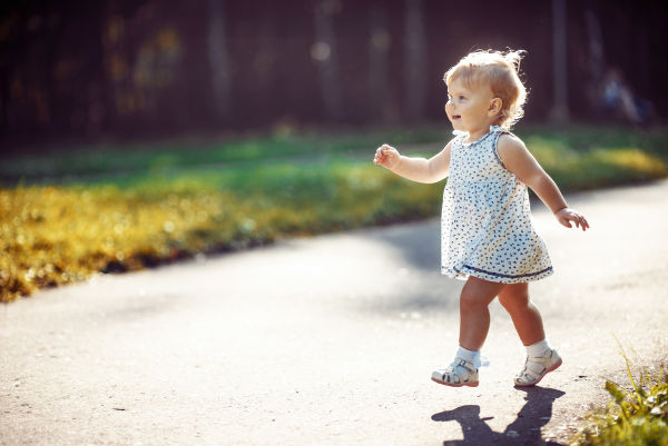 Little girl walking in park