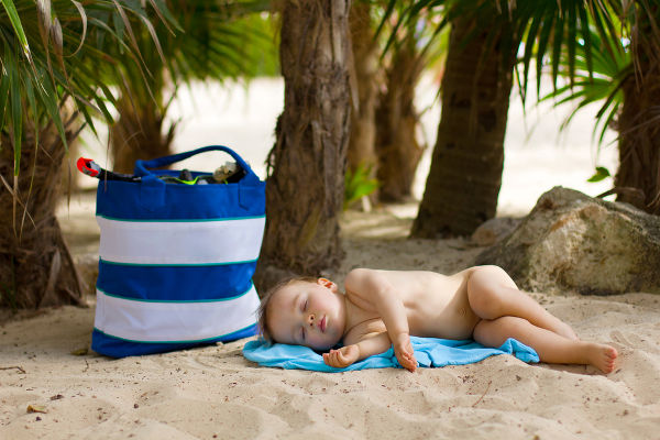 Baby asleep on beach