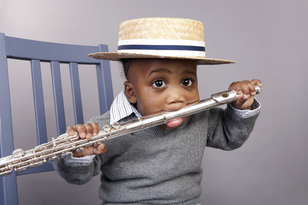 Baby boy with flute in his mouth