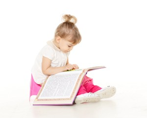 Girl reading and potty training