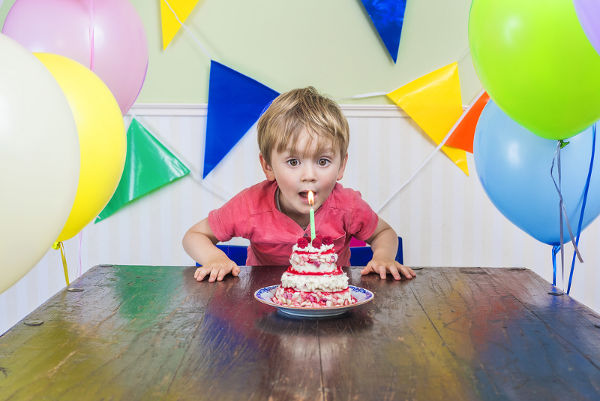 kid with birthday cake