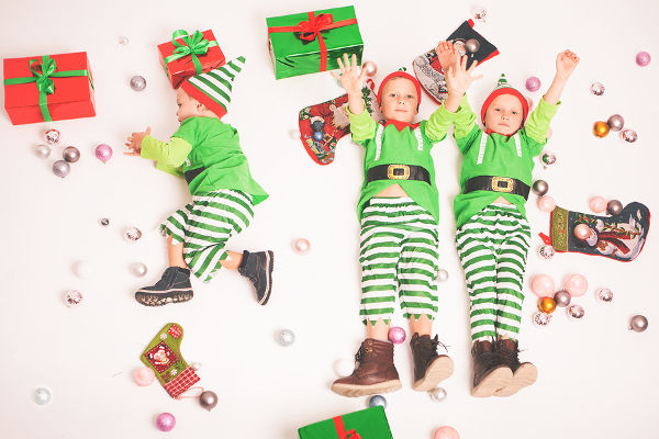 4 Kids dressed in elf costumes