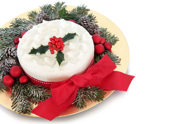 Traditional christmas cake with red bauble decorations