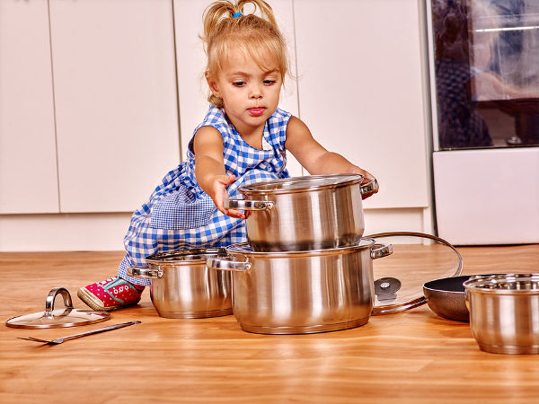 Child banging on saucepans