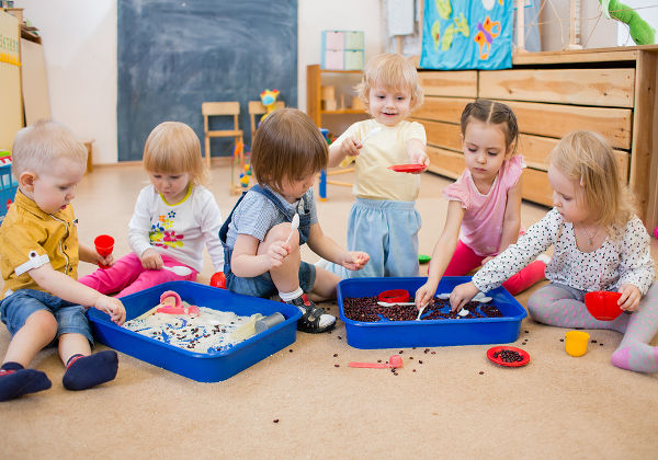 Children improving motor skills of hands in kindergarten