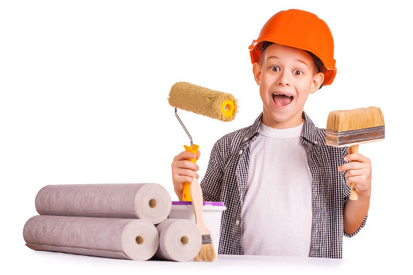 funny boy with a roll of wallpaper and brush