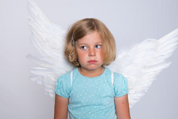 little blond girl with angel- wings is sad
