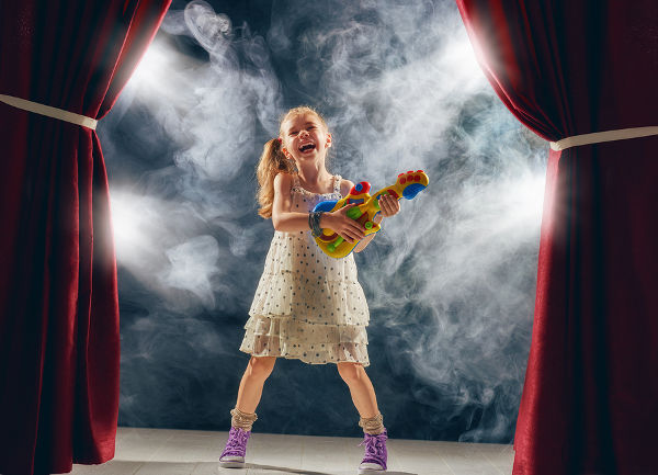 young girl rock star on stage