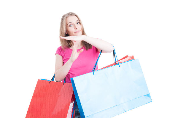Woman doing timeout or pause gesture while doing shopping