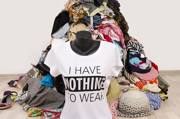 Untidy cluttered wardrobe with colorful clothes and accessories