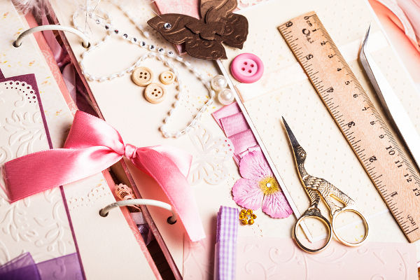 The making scrapbooking album with tolls and pink decorations