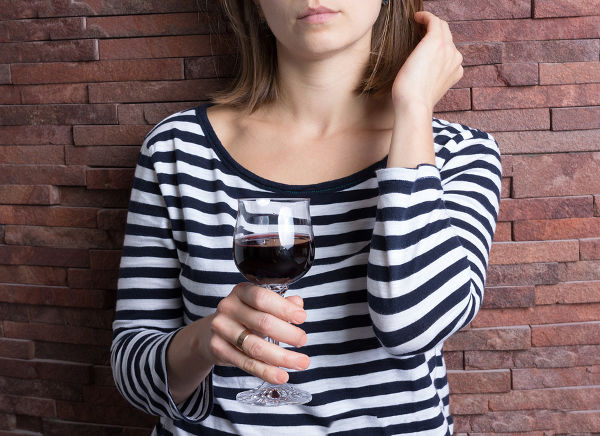 Girl holding a glass of red wine