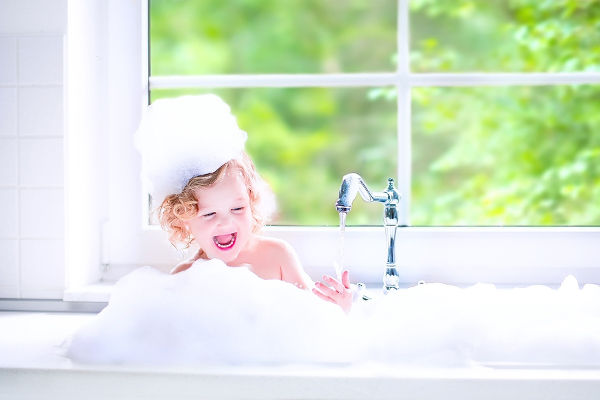 girl having bubble bath