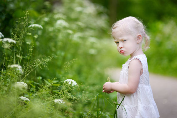 Portrait of a very angry little girl outdoors