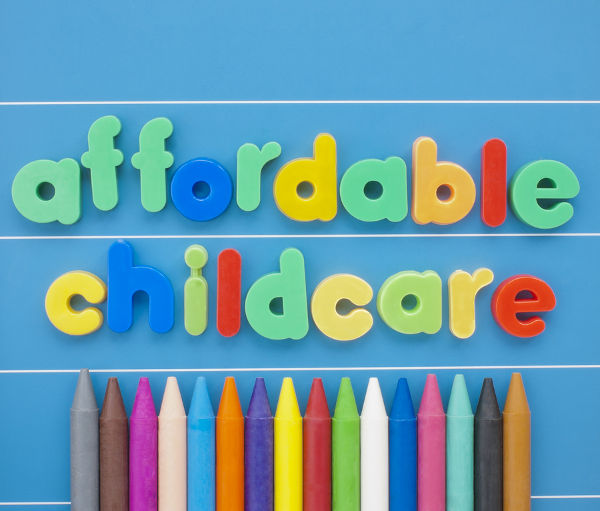 Magnetic letters spelling Affordable Childcare on a blue board.