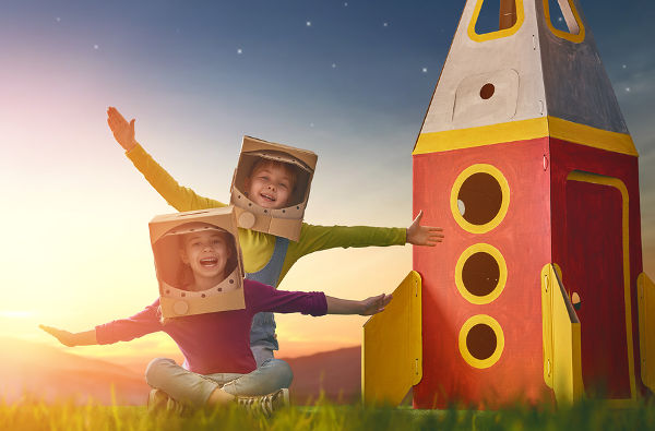 children-in-astronaut-costumes-with-cardboard-rocket-ship