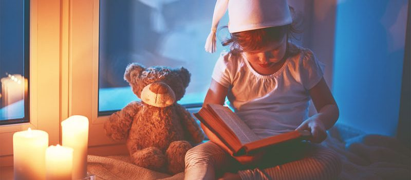 feature child-reading-before-bed