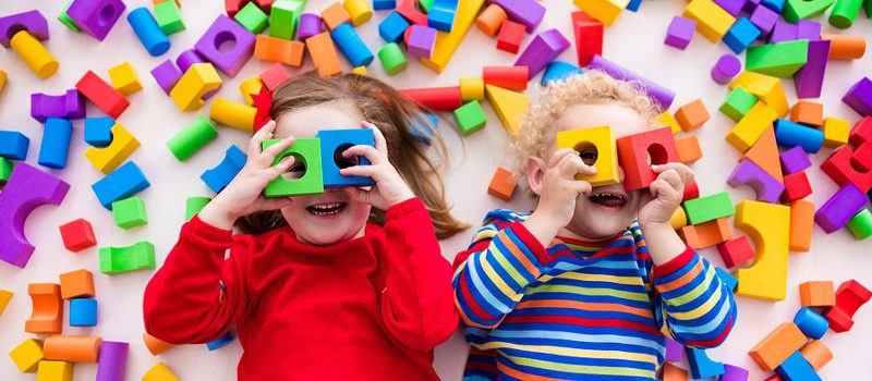 feature kids with toy blocks