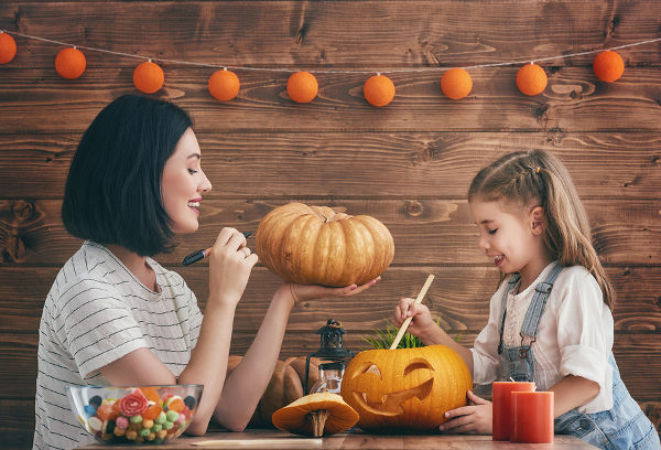 mother-and-daughter-carving-pumpkins