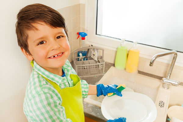 boy-cleaning-plates