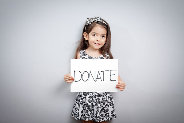 girl-with-donate-sign