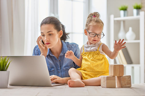 young-mother-working-toddler-playing-with-blocks