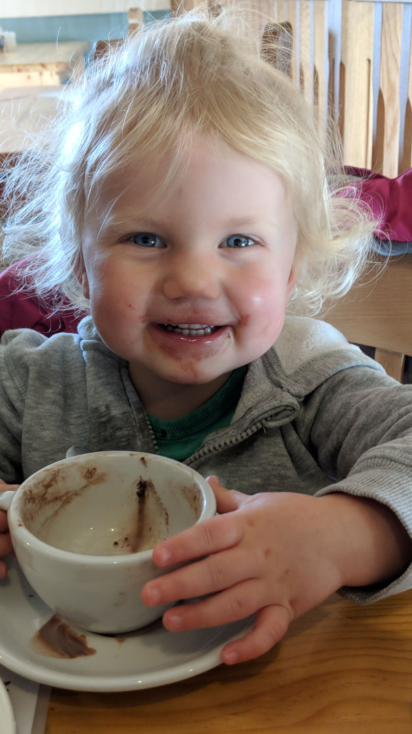 Child with hot chocolate