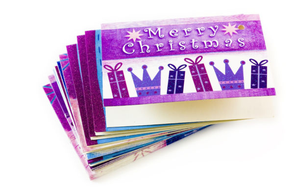 Christmas tags in a pile on white background