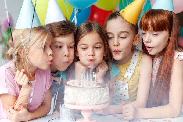 birthday-party-girls-blowing-out-candles