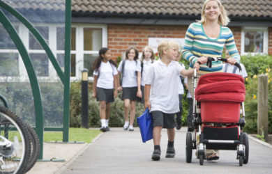 Woman Leaving School With Child And Push Chair