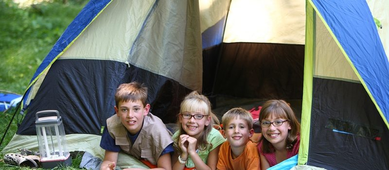 Kids camping in a tent
