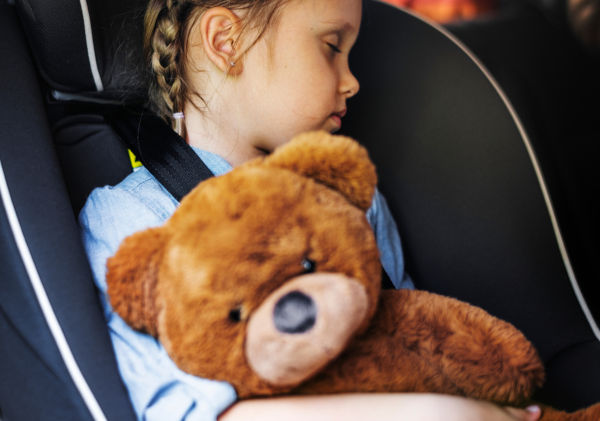 Little girl sleeping in the car