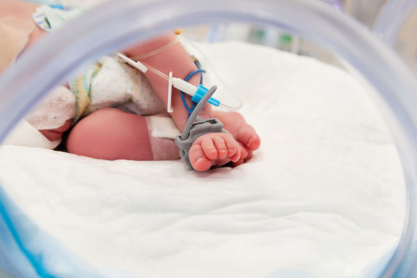 baby in hospital with a drip line.