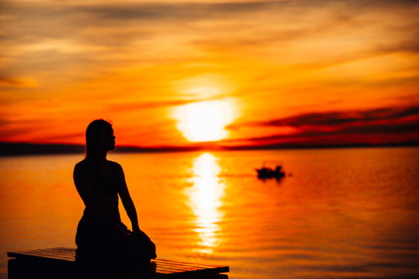 Carefree Woman Meditating In Nature.