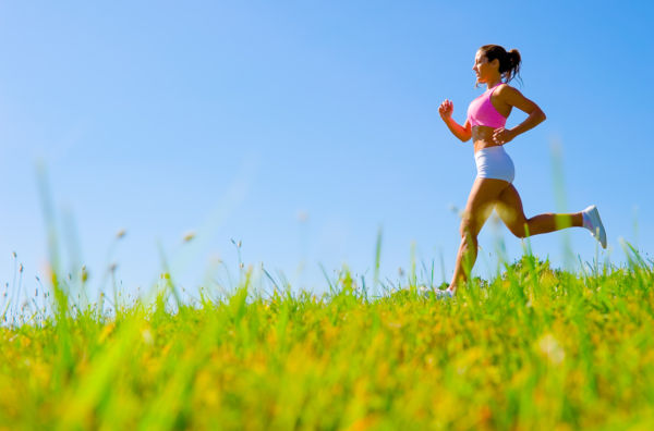 Athletic woman working out in a meadow