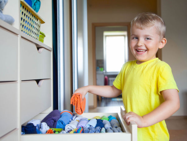 Boy choosing outfit from wardrobe