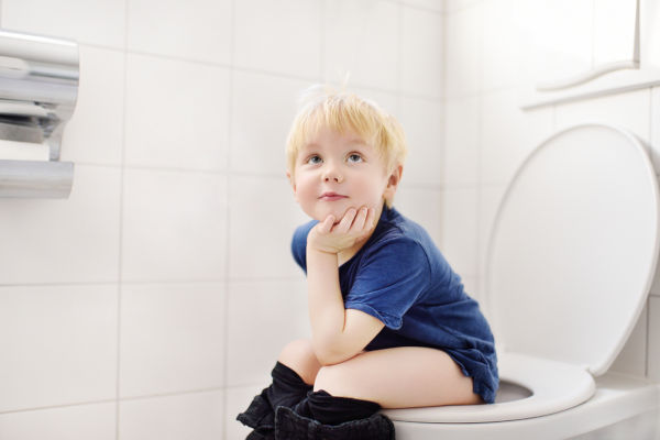 Cute Little Boy In Restroom. Toddler Child Training Use Toilet.