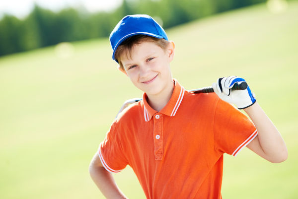 Boy golf player portrait with club