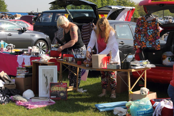 People selling at a car boot sale