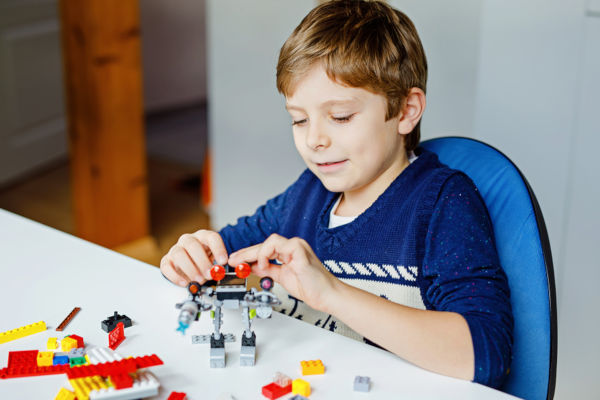 Child playing with Lego.