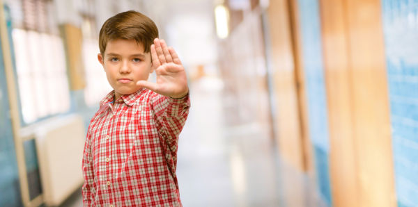 Child using hand to tell someone to stop