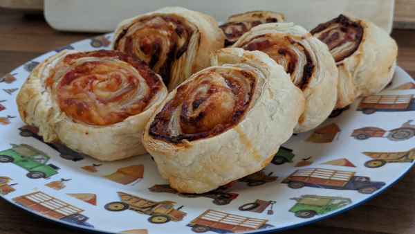Pizza wheels made from puff pastry on a plate